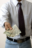 Business man giving money Royalty Free Stock Photography