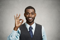 Business man giving ok sign Royalty Free Stock Photos