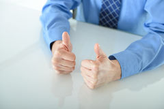 Business man giving two big thumbs up. For success royalty free stock image
