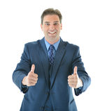 Business man giving two big thumbs up. Successful happy business man giving two big thumbs up for a job well done stock images