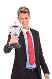 Business man giving you a trophy Stock Photo