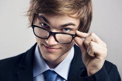 Business man with glasses. Portrait of a handsome business man wearing glasses Royalty Free Stock Images