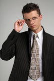 Business man in glasses. On gray Royalty Free Stock Images