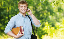 Business man glasses books phone royalty free stock image