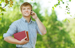 Business man glasses books phone Stock Photo