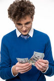 Business man in glasses counting money Stock Photo