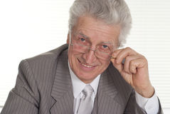 An business man in glasses sitting Stock Image