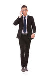 Business man with glasses talking on mobile phone Stock Photography