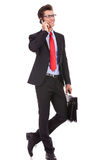 Business man with glasses talking on phone Royalty Free Stock Photography