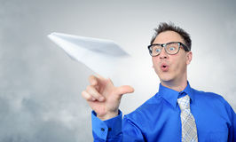 Business man in glasses throwing a paper plane Stock Images