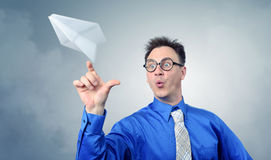 Business man in glasses throwing a paper plane Royalty Free Stock Photography