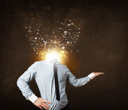 Business man with glowing exploding head Royalty Free Stock Photos