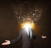 Business man with glowing exploding head. Concept royalty free stock photography