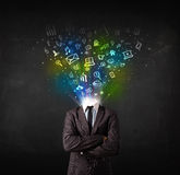 Business man with glowing media icons exploding head. Concept Stock Image
