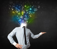 Business man with glowing media icons exploding head Stock Photos