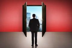 Business man going to the open door Stock Image