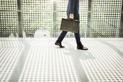 Business Man Going Walking to Work Concept Royalty Free Stock Photo