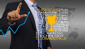 Business man with golden trophy Stock Image