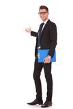 Business Man Gpresentin Holding A Clipboard Royalty Free Stock Photography
