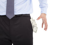 Business man grabbing  pocket money Royalty Free Stock Image