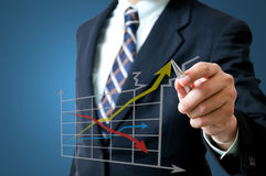 Business man with graph. Business man with growing graph Stock Image