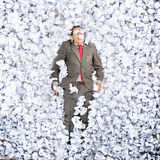 Business man with a great heap of crumpled papers. Swimming in paper ocean concept Stock Photography