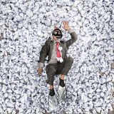 Business man with a great heap of crumpled papers. Swimming in paper ocean concept Royalty Free Stock Photography