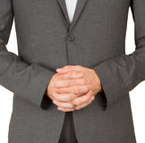 Business man in grey suit praying Stock Image