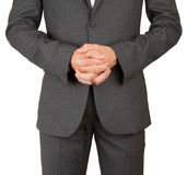 Business man in grey suit praying Stock Images
