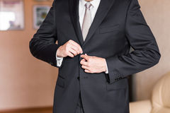 Business man or Groom wearing suit on wedding day and preparing. Royalty Free Stock Image