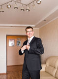 Business man or Groom wearing suit on wedding day and preparing. Stock Photos