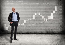 Business man and a growing graph Stock Image