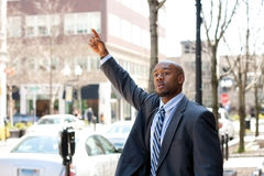Business Man Hailing a Taxi Cab Royalty Free Stock Photography