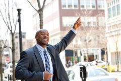 Business Man Hails a Taxi Royalty Free Stock Image
