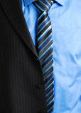 Business man with half suit. This is a an image of business man wearing a tie, shirt and a partially worn suit Stock Photos