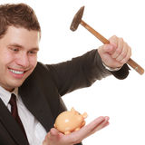 Business man with hammer about to smash piggy bank. Money saving concept. Happy funny business man guy with hammer about to smash piggy bank isolated on white Royalty Free Stock Images