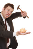 Business man with hammer about to smash piggy bank Stock Photos