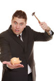 Business man with hammer about to smash piggy bank. Money saving concept. Nerdy funny business man guy with hammer about to smash piggy bank isolated on white Stock Photography