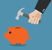 Business man hand breaking piggy bank Royalty Free Stock Photos