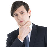 Business man with hand on chin Royalty Free Stock Image
