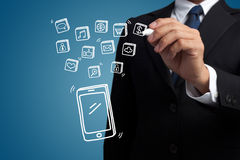 Business man hand draw smartphone and social media Royalty Free Stock Photo