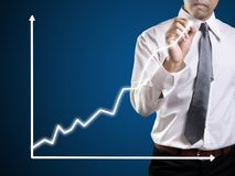 Business man hand drawing a graph royalty free stock photos