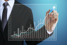 Business man hand drawing  graph Stock Images