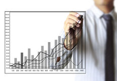 Business man hand drawing graph Royalty Free Stock Images