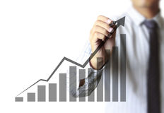 Business man hand drawing graph Stock Image