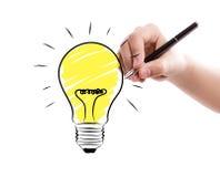 Business man hand drawing light bulb stock image