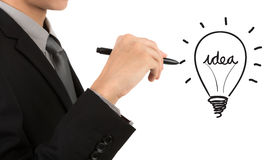 Business man hand drawing light bulb Stock Photos