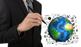 Business man hand drawing success graph with earth. (Elements of this image furnished by NASA Stock Photo