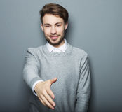 Business man with hand extended to handshake Royalty Free Stock Images