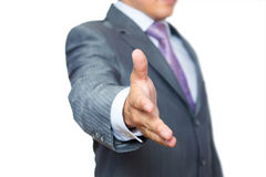 Business man with hand extended to handshake Stock Images